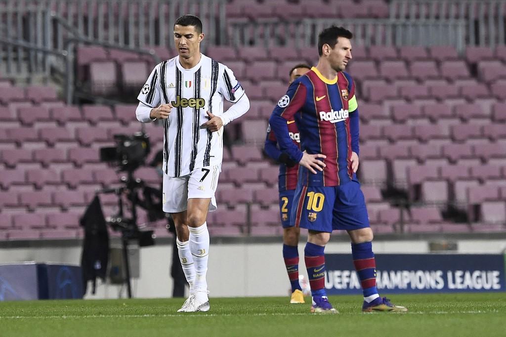 Ronaldo (balra) és Messi a tavaly decemberi Barca-Juve (0-3) BL-rangadón